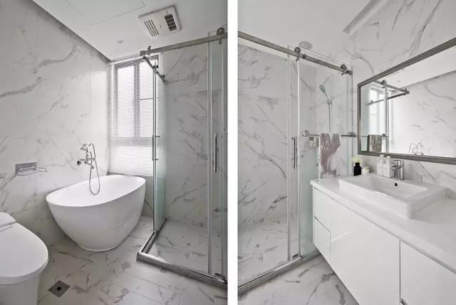 卫生间整体通铺大理石瓷砖,独立浴缸与淋浴房设计,打造轻奢风洗漱