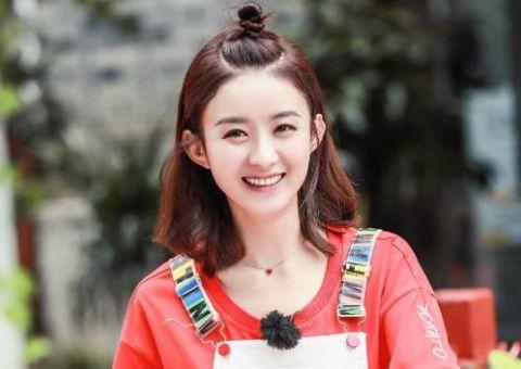 2,赵丽颖,凭借清丽可爱的外貌深得观众的喜欢,丸子头这样扎,看着既
