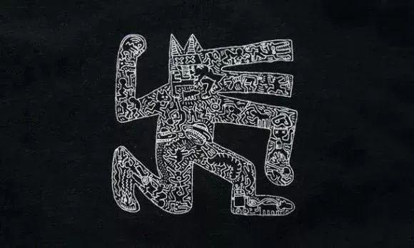 keith haring 白色粉笔涂鸦而成的狗图案.
